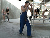 Busty brunette whore gets gangbanged by factory workers
