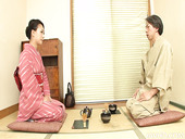 Traditional Japanese housewife YAYOI YANAGIDA is serving her guests