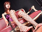 Dominant Japanese whore Itsuka gives a great footjob to her slave